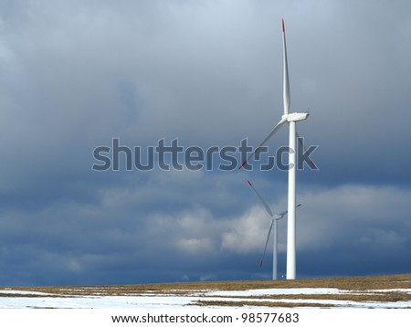 wind power station with cloudy sky