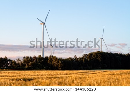 Wind Power Stations in a Corn Field, Bavaria Germany - stock photo