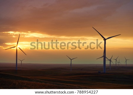 Wind power stations. Wind power is the use of air flow through wind turbines to mechanically power generators for electric power.