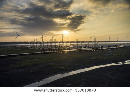 Wind power turbine at Taichung Gaomei wetlands during sunset.