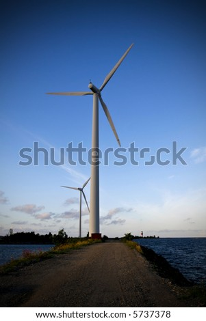 wind power turbine in front of a clear blue sky