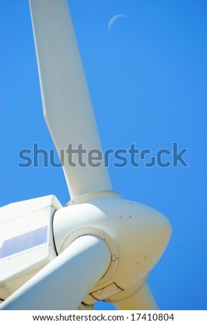 Wind power - turbine installation with blue sky and moon - stock photo