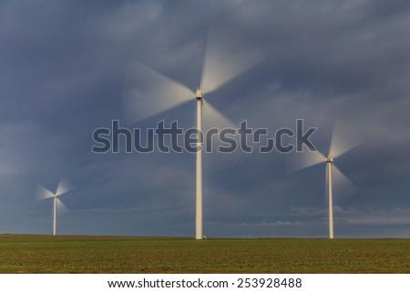 wind power turbines on a hill in morning. Dobrogea, Romania - stock photo