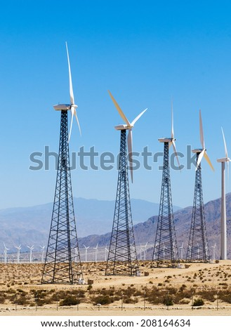 Wind powered alternate energy power generating farm in southern California - stock photo