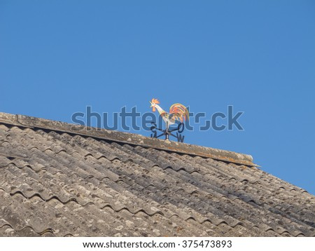 Wind rooster on the roof