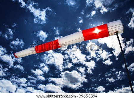 wind sleeve flying on a blue sky - stock photo