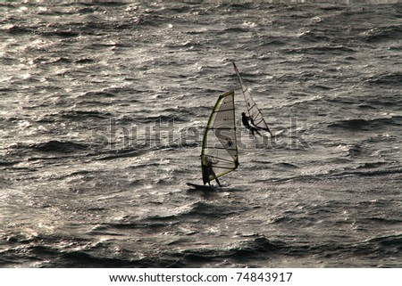 Wind surfer at Palma Nova in Majorca in silhouette.