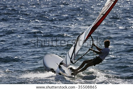wind surfer heading open sea
