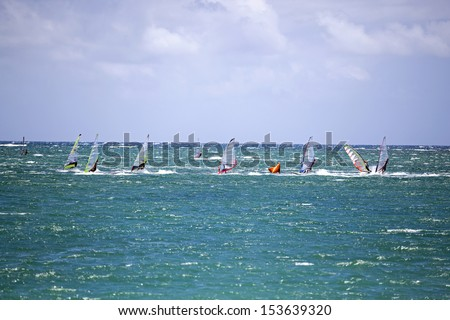 Wind Surfers off Kanaha Beach Park, Maui, Hawaii - stock photo