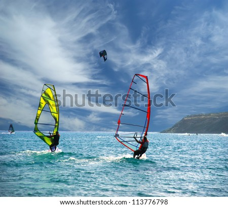 Wind Surfers On The Ocean - stock photo