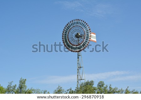 Wind turbine, a turbine having a large vaned wheel rotated by the wind to generate electricity. Wind generator, Wind power unit  - stock photo