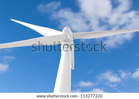 Wind turbine against blue cloudy sky. - stock photo
