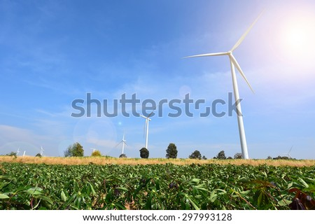 wind turbine against cloudy blue sky background  - stock photo