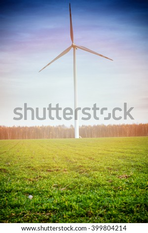 Wind turbine against deep blue sky -