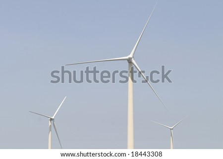 Wind turbine against sky - stock photo