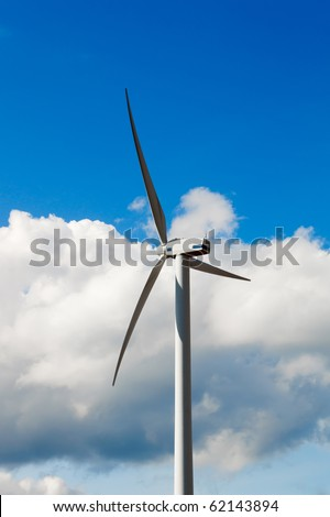 Wind Turbine - alternative and green energy source in sunny daby with blue sky