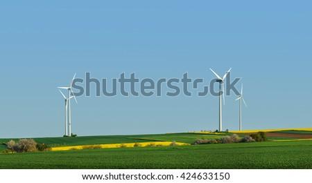 Wind turbine, alternative energy source - stock photo