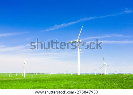 wind turbine and meadow under sky