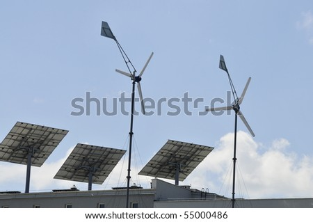 Wind turbine and solar panels on roof top