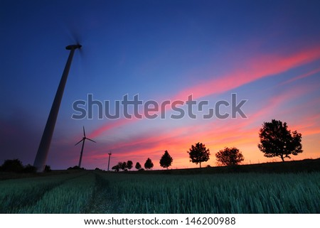 Wind turbine and wheat farm at sunset in Germany