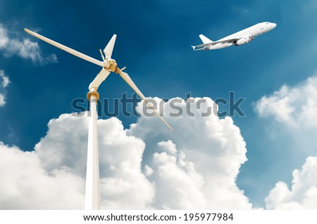 Wind turbine and white passenger airplane in the blue sky - stock photo