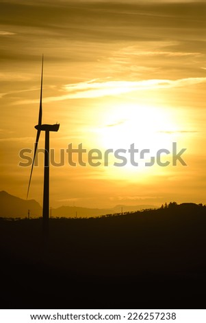 wind turbine at sunset in Andalusia, Spain - stock photo
