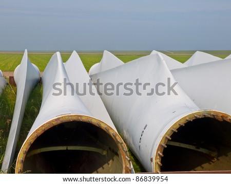 wind turbine blades awaiting assembly - stock photo