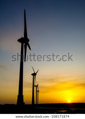 Wind turbine durng sunset