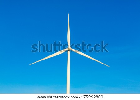 Wind turbine electric  generator with blue sky in Huai Bong district, Thailand