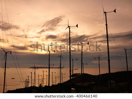 Wind turbine farm and sunset  - stock photo