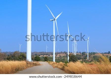 Wind turbine farm, generating electricity - stock photo