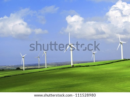 Wind turbine farm on a hillside in Cornwall  England. - stock photo