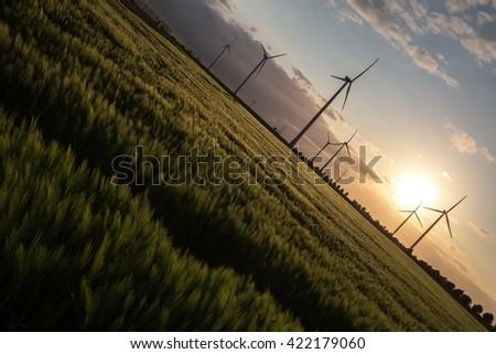 wind turbine farm sundown - stock photo