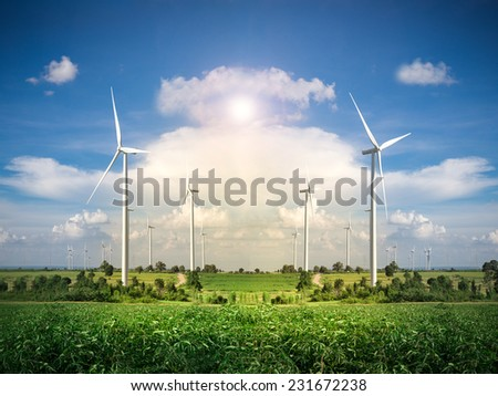 Wind Turbine Farm with Blue Sky and Sunlight - stock photo