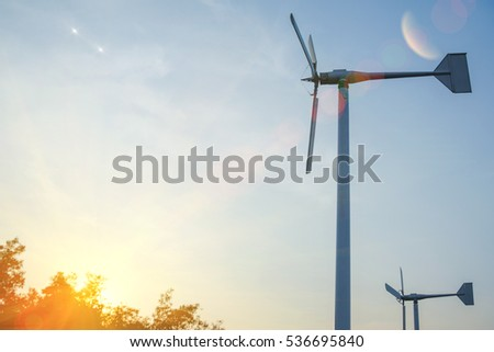 Wind turbine farm with sun lighting flare effect, Thailand.