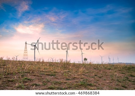 Wind Turbine for alternative energy at sunset in Thailand,Soft Focus