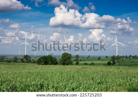 Wind Turbine for alternative energy on background sky on Cassava plantation
