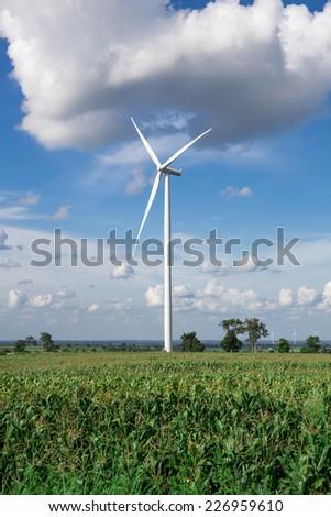 Wind Turbine for alternative energy on background sky on Cassava plantation - stock photo