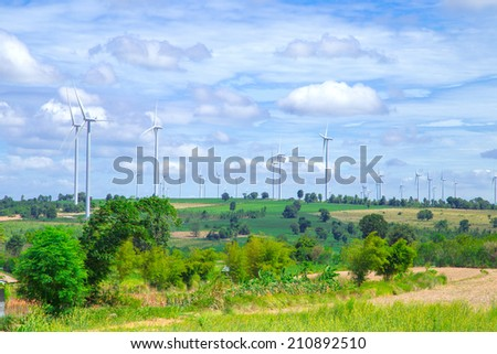 Wind Turbine for alternative energy on sky background. Green world.   - stock photo