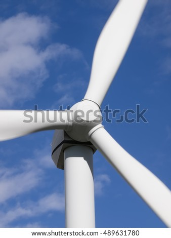 Wind turbine front view close-up on blue sky