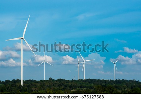Wind turbine generates electricity in agricultural fields, so that alternative energy from nature is clean energy does not affect the way of life of the community.