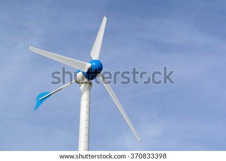wind turbine generating electricity on blue sky - stock photo