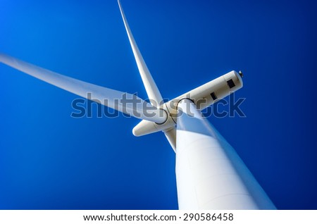 Wind turbine generating electricity on blue sky , Ecology - stock photo