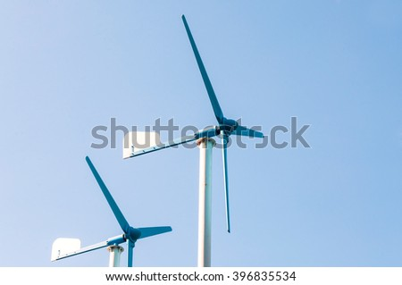 Wind turbine generator, alternative energy source - stock photo