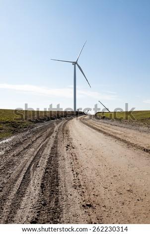 Wind turbine generator of green alternative energy - stock photo