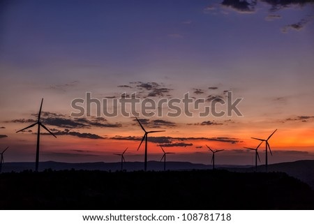 Wind Turbine Generators at sunset - Eolic Energy - stock photo