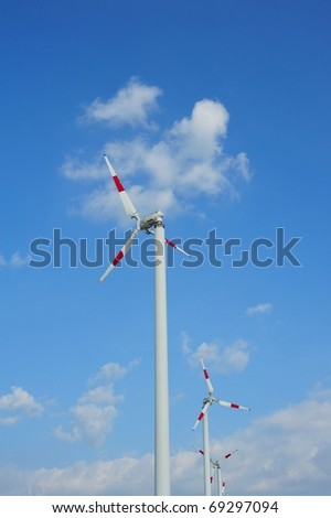 wind turbine generators on blue sky