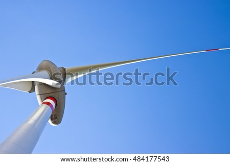 Wind turbine in a blue sky with copy space