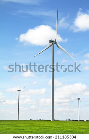 Wind turbine in a green field. Renewable energy source. - stock photo
