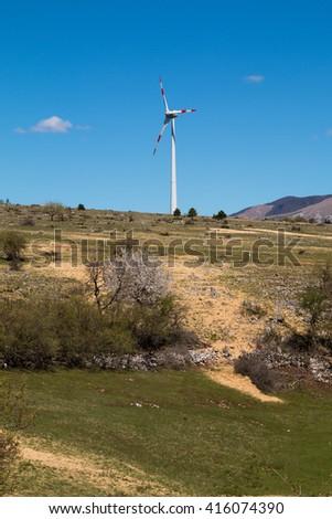 Wind turbine in spring - stock photo